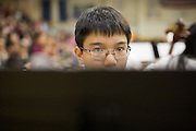 Archy Tran, Russell Middle School 8th grade, looks at his notes while playing the Bass Clarinet during the Milpitas Unified School District's 11th Annual Music Festival at Milpitas High School in Milpitas, California, on April 10, 2014. (Stan Olszewski/SOSKIphoto)