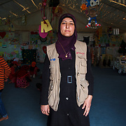 Reema, 31,  and her family fled Damascus for Jordan one year ago. Reema sold all of her gold before the journey, except the gold heart necklace her mother gave her when she gave birth to her first son, Adnan.<br /> <br /> Reema teaches knitting and sewing to girls in Mercy Corps' adolescent friendly spaces in Azraq camp for Syrian refugees, Jordan, May 2015.