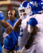 Kentucky Wildcats head coach Joker Phillips looks toward the field during the first half of a game against the Arkansas Razorbacks at Donald W. Reynolds Razorback Stadium in Fayetteville, Ark., on Oct.. 13, 2012. Photo by Beth Hall