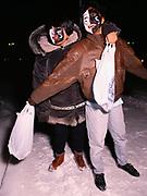 Two Inupiat boys trick-or-treating on Halloween, Barrow, Alaska.