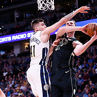 01 April 2018: Milwaukee Bucks center Tyler Zeller (44) goes for the reverse layup past Denver Nuggets forward Juan Hernangomez (41) during the Denver Nuggets 128-125 victory over the Milwaukee Bucks, at the Pepsi Center, Denver, Colorado, USA.