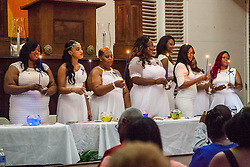 Ten graduates of the University of the Virgin Islands School of Nursing commemorated their graduation with a pinning ceremony and lighting of candles while surrounded by nursing alumni, family, and friends.  University of the Virgin Islands School of Nursing 2015 Pinning Ceremony.  St. Thomas Reformed Church.  St. Thomas, VI.  12 May 2015.  © Aisha-Zakiya Boyd