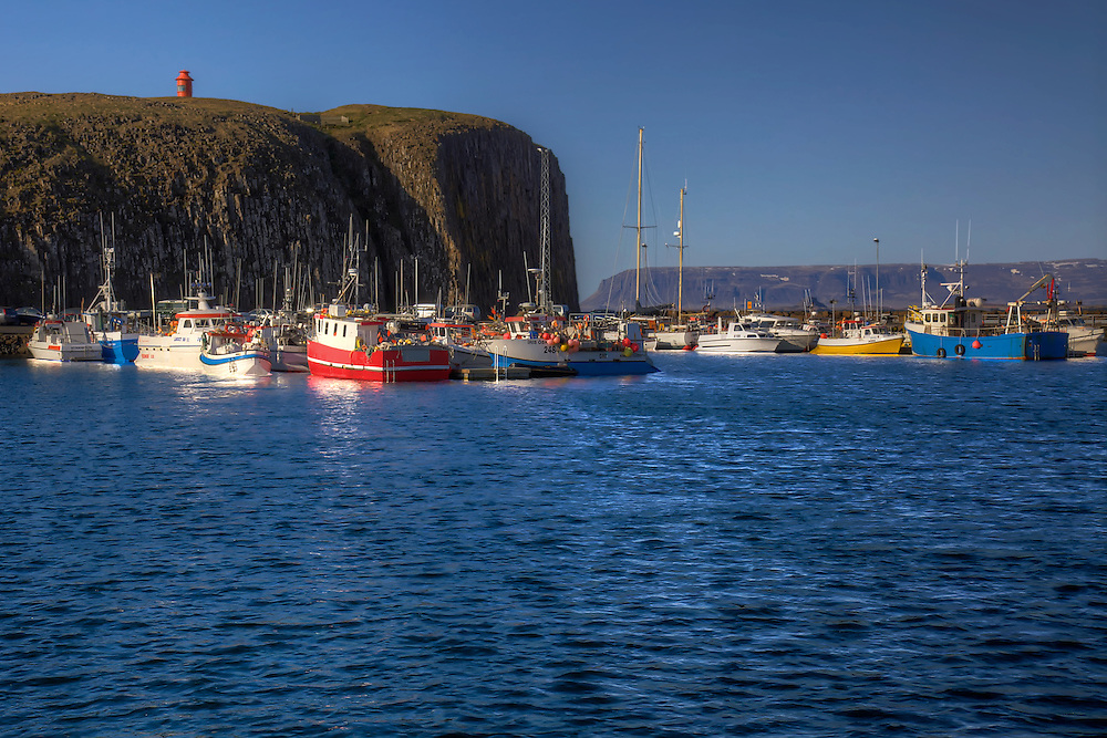 Colorful boats at Stykkishólmur harbor on the Snaefellsnes Peninsula in western Iceland.