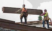 Contractors and crews celebrate the topping out at Wisdom High School, June 10, 2016.