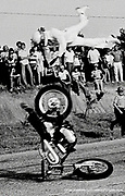 Bob Pleso died after he came up short attempting a ramp to ground jump over 30 cars on August 4, 1974. As Pleso came to speed and left the launch ramp the wind shifted, depriving him of airborne speed. His rear motorcycle tire dropped prematurely coming down on a car. Pleso flipped violently through the air and hit the asphalt, skidding several hundred feet to a stop. He died at a local hospital several hours later. Photographs © 1974 Ken Hawkins/KenHawkinsPictures.com #motorcycle #daredevil #moment #fatalmotorcyclejump<br /> #AlexHarvill #KenHawkins #photojournalism #bobpleso #motorcycle #FCRM9R