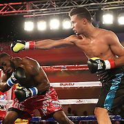Alphonso Black (L) ducks below the right hand of Daniel Rosario during a Telemundo Boxeo boxing match at the A La Carte Pavilion on Friday,  March 13, 2015 in Tampa, Florida. Rosario won the bout by TKO.  (AP Photo/Alex Menendez)