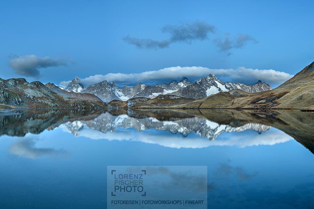 Reflections of Grandes Jorasses, Aiguille du Talefre, Aiguille du Triolet and Mont Dolent in the Lac de Fenetre, Great St. Bernard Pass Area, Martigny, Valais, Switzerland