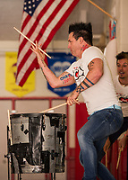 Justin Spencer and Ryan Vezina of Recycled Percussion perform a drum solo for the students and faculty at Pleasant Street School during a surprise visit on Friday afternoon.  (Karen Bobotas/for the Laconia Daily Sun)