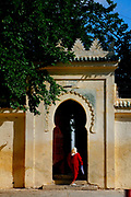 Early Monday morning, May 28, 2007, a woman enters a typical Fassi doorway just outside the King's Palace in Fes, Morocco. (PHOTO BY TIMOTHY  D. BURDICK)