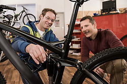 Customer and salesman in bike shop