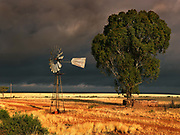 Storm over borehole pump, Namibia