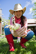 Kerry Newberry with a turkey chick at Leaping Lamb Farm.