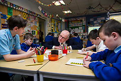 Pictured: John Swinney joined in a primarty six art class<br /> <br /> Today Deputy First Minister John Swinney visited Niddrie Mill Primary School to announce the publication of Scottish school statistics such as teacher numbers, ratios and class sizes. <br /> <br /> <br /> Ger Harley   EEm 12 December 2017