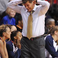 Mar 2, 2009; Piscataway, NJ, USA; Connecticut head coach Geno Auriemma reacts to a scoring run by Rutgers during the second half of Rutgers game against nationally rated #1 Connecticut at the Louis Brown Athletic Center.  Connecticut won 69-59 to finish their regular season a perfect 30-0.