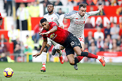 Manchester United's Marcus Rashford (left) and Liverpool's Xherdan Shaqiri battle for the ball during the Premier League match at Old Trafford, Manchester.