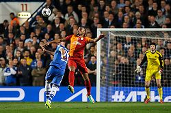Chelsea Defender John Terry (ENG) and Galatasaray Forward Didier Drogba (CIV) compete in the air - Photo mandatory by-line: Rogan Thomson/JMP - 18/03/2014 - SPORT - FOOTBALL - Stamford Bridge, London - Chelsea v Galatasaray - UEFA Champions League Round of 16 Second leg.