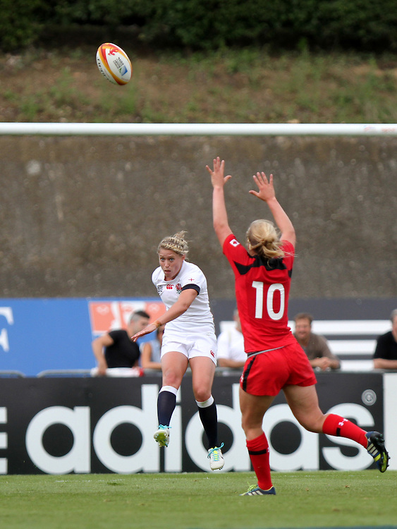 Natasha Hunt kicks the ball. England v Canada Pool A match at WRWC 2014 at Centre National de Rugby, Marcoussis, France, on 9th August 2014