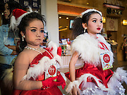 17 SEPTEMBER 2015 - BANGKOK, THAILAND: Participants in the Santa pageant wait to go on stage at the World Santa Claus Congress. Twenty-six Santa Clauses from around the world are in Bangkok for the first World Santa Claus Congress. The World Santa Claus Congress has been an annual event in Denmark since 1957. This year's event, hosted by Snow Town, a theme park with a winter and snow theme, hosted the event. There were Santas from Japan, Hong Kong, the US, Canada, Germany, France and Denmark. They presented gifts to Thai children and judged a Santa pageant. Thailand, a Buddhist country, does not celebrate the religious aspects of Christmas, but Thais do celebrate the commercial aspects of the holiday.    PHOTO BY JACK KURTZ