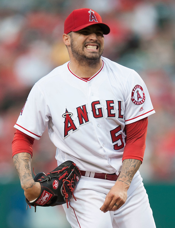 The Angels' Hector Santiago reacts during a rough first inning against the Cleveland Indians Friday at Angel Stadium. Santiago gave up six runs, five earned, on seven hits in one and a third innings.<br /> <br /> ///ADDITIONAL INFO:   <br /> <br /> angels.0611.kjs  ---  Photo by KEVIN SULLIVAN / Orange County Register  -- 6/10/16<br /> <br /> The Los Angeles Angels take on the Cleveland Indians Friday at Angel Stadium.