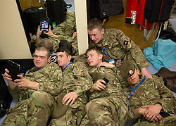 © Licensed to London News Pictures. 07/11/2014.  London.  Soldiers from Nijmegen Company of the Grenadier Guards take time out before today's Festival of Remembrance.  First broadcast in 1927 the festival has now been held in the Royal Albert Hall for 87 years.  Photo credit : Alison Baskerville/LNP