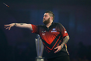Michael Smith throwing darts during the 2019 William Hill World Darts Championship Final at Alexandra Palace, London, United Kingdom on 1 January 2019.