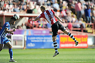 Exeter City forward Robbie Simpson (8) headed knockdown is intercepted by Hartlepool United defender Jake Carroll (3)  the ball during the EFL Sky Bet League 2 match between Exeter City and Hartlepool United at St James' Park, Exeter, England on 13 August 2016. Photo by Graham Hunt.