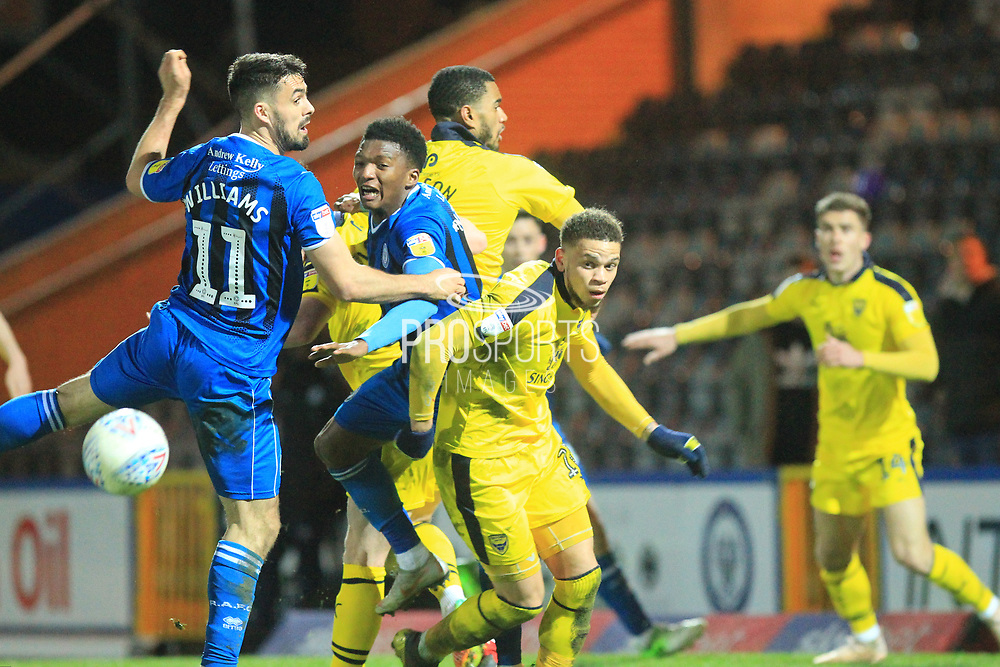 Jordan Williams and Kgosi Nthle try and win the ball during the EFL Sky Bet League 1 match between Rochdale and Oxford United at Spotland, Rochdale, England on 12 March 2019.