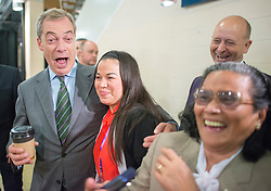 © Licensed to London News Pictures. 26/09/2014. Doncaster, UK. Leader of UKIP Nigel Farage arrives at the conference ahead of his speech.  The UKIP conference at Doncaster Racecourse Friday 26th September 2014. Photo credit : Stephen Simpson/LNP