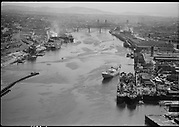 """Ackroyd 01672-1 """"Misc. aerials. August 9, 1949"""".  """"Harbor district looking south"""" (Wisco on right, UP Albina yard on left. Note dredge in river)"""