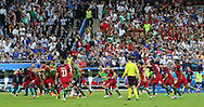 Portugal Forward Eder is mobbed by his players after their win during the Euro 2016 final between Portugal and France at Stade de France, Saint-Denis, Paris, France on 10 July 2016. Photo by Phil Duncan.