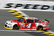 NASCAR auto racing driver Kevin Harvick crosses the start-finish line during practice at Kansas Speedway in Kansas City, Kan., Saturday, Oct. 4, 2014. (AP Photo/Colin E. Braley)