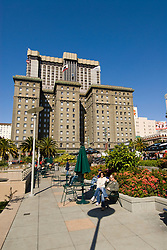California, San Francisco: Couple relaxing at Union Square. Photo 10-casanf79260.  Photo copyright Lee Foster.