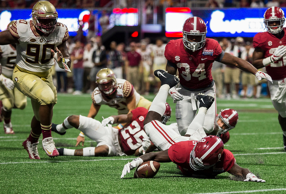Alabama Crimson Tide running back Josh Jacobs (8) recovers a blocked punt during the Chick-fil-A Kickoff NCAA football game on Saturday, September 2, 2017, in Atlanta. (Jason Parkhurst via Abell Images for Chick-fil-A Kickoff Game)