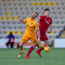 Livingston Lee Miller and Aberdeen's Scott McKenna. half time : Livingston 0 v 0 Aberdeen, SPFL Ladbrokes Premiership played 29/1/2018 at Livingston home ground, Tony Macaroni Arena.