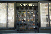 """March, 27th 2020 - Paris, Ile-de-France, France: Paris under confinement, Chanel, Avenue Montaigne area of high fashion, beauty, accessories, haute couture, all shops closed, in 8th arrondissement, and all public spaces virtually empty to stop the spread of the Coronavirus, during the eleventh day of near total lockdown imposed in France. The President of France, Emmanuel Macron, said the citizens must stay at home for at least 15 days, that has been extended. He said """"We are at war, a public health war, certainly but we are at war, against an invisible and elusive enemy"""". All journeys outside the home unless justified for essential professional or health reasons are outlawed. Anyone flouting the new regulations is fined. Nigel Dickinson"""