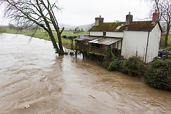 © Licensed to London News Pictures. 21/02/2021. Whitney-on-Wye, Herefordshire, UK. The river Wye bursts it's banks at Whitney-on-Wye in Herefordshire, UK. Photo credit: Graham M. Lawrence/LNP