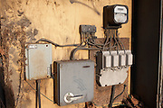 Detail of an exposed junction box and analogue electricity meter on an industrial estate in West Ham substation, Canning Town