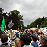 Danny Chivers from No Dash for Gas speaks to the crowd outside the gates to the Cuadrilla fracking site. Thousands turned out for a march of solidarity against fracking in Balcombe. The village Balcombe in Sussex is the  centre of fracking by the company Cuadrilla. The march saw anti-fracking movements from the Lancashire and the North, Wales and other communities around the UK under threat of gas and oil exploration by fracking.