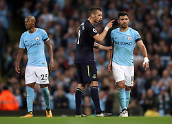 Everton's Morgan Schneiderlin argues with Manchester City's Sergio Aguero (right) after being shown a second yellow card for a tackle on Aguero during the Premier League match at the Etihad Stadium, Manchester.