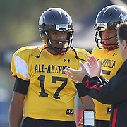 Quarterback Brett Hundley (17) listens to coach Steve Mariucci during the practice session at the Walt Disney Wide World of Sports Complex in preparation for the Under Armour All-America high school football game on December 3, 2011 in Lake Buena Vista, Florida. (AP Photo/Alex Menendez)