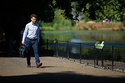 © Licensed to London News Pictures. 24/07/2018. London, UK. A commuter walks to work this morning in St James' Park. Temperatures in the South East of the UK are reaching over 30 degrees celsius today, following the hottest day of the year yesterday. Photo credit : Tom Nicholson/LNP