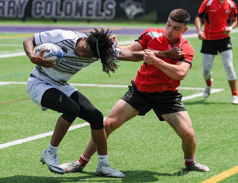 Cambridge Rindge & Latin junior Traevon Mosley tries to break away from Milton senior Alex Mavridis during the MIAA Division 2 State Championship match against Milton High School at the Walter M. Katz field at Curry College in Milton, June 22, 2019. Milton won the game, 41-12.   [Wicked Local Photo/James Jesson]