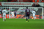 Swansea city's Jonathan De Guzman (20) scores his sides 3rd goal.  Barclays premier league, Swansea city v Stoke city at the Liberty Stadium in Swansea on Saturday 19th Jan 2013. pic by Andrew Orchard, Andrew Orchard sports photography,