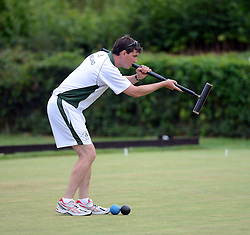 © Licensed to London News Pictures. 14/08/2013. Surbiton, UK Andrew Johnston, Ireland in action. People participate in the14th World Association Croquet Championship at the Surbiton Croquet Club, Kingston upon Thames on the 14th August 2013. The Final will be played on Sunday 18th August. 80 competitors from 20 countries are taking part. Photo credit : Mike King/LNP