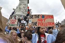 School pupils call for radical climate action in UK-wide strike in which thousands of young people from around the country took part - more than 15,000 marched from  Parliament Square to Downing Street, UK. Here, students near Buckingham Palace. 15 March 2019