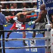 LAS VEGAS, NV - SEPTEMBER 13: Marcos Maidana (L) throws an overhand left at Floyd Mayweather Jr. during their WBC/WBA welterweight title fight at the MGM Grand Garden Arena on September 13, 2014 in Las Vegas, Nevada. (Photo by Alex Menendez/Getty Images) *** Local Caption *** Floyd Mayweather Jr; Marcos Maidana