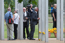 © London News Pictures. 07/07/15. London, UK. Families of those killed and survivors lay flowers at the 7/7 Memorial at the end of the service in Hyde Park to mark the 10 year anniversary of the 7/7 London bombings, Central London. Photo credit: Laura Lean/LNP