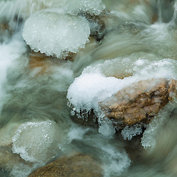 Ice on the rocks in a small stream near Ammonoosuc Lake in New Hampshire's White Mountains.
