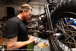 Roland with a Knucklehead project he's working on in a smaller shop by his upstairs office at his Roland Sands Design (RSD) retail and office location, Los Alamitos, CA. Monday June 25, 2018. Photography ©2018 Michael Lichter.