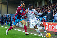 Wycombe Wanderers midfielder Fred Onyedinma (19) holds off Scunthorpe United midfielder Levi Sutton (22) during the EFL Sky Bet League 1 match between Scunthorpe United and Wycombe Wanderers at Glanford Park, Scunthorpe, England on 29 December 2018.